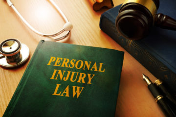 Personal injury law book on the desk of a Radford personal injury lawyer.